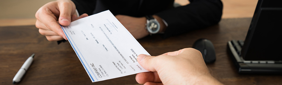 person handing over check